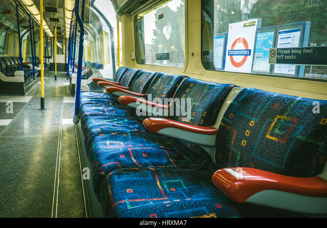 A row of empty seats on a London Underground tube train - Stock Image