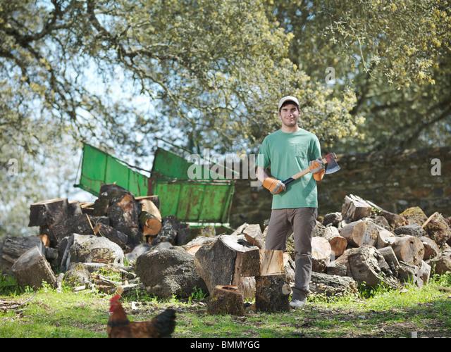 Man chopping wood on farm - Stock Image