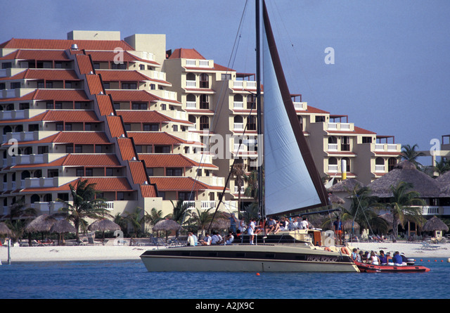 Aruba Palm Beach Tourist Sailboat in front of hotel - Stock Image