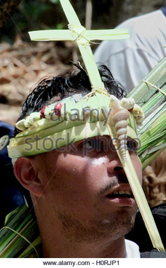 A Venezuelan wears a cross made of palms in Caracas, March 23, 2002.  Palms are used as part of celebrations for - Stock Image