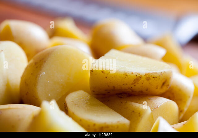 New potatoes sliced and ready - Stock Image