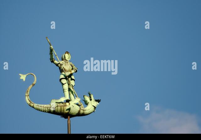 Gdansk Poland. Saint George slaying the dragon. Statue on top of spire of 15th C. St. Georges Hall in the Old Town - Stock Image