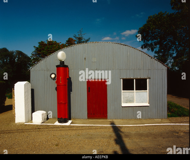 old style gas station with petrol pump outside - Stock Image