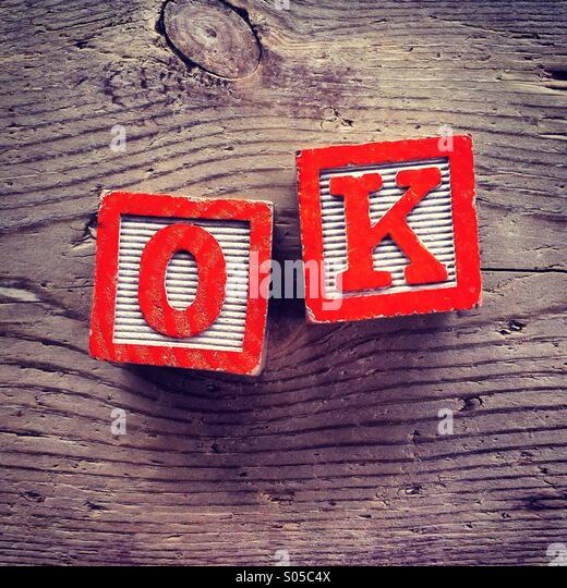 It's a photo of wood blocks toy with letters that form the acronym word OK - Stock-Bilder