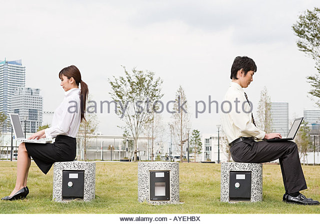 Businesspeople using laptops - Stock Image