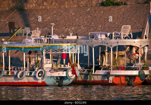 Aswan small colorful passenger ferry boats Nile River Aswan Egypt traditional transport vessel - Stock Image