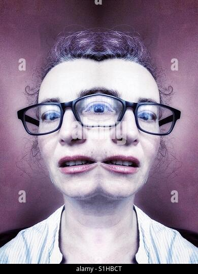 Freaky portrait of woman with three eyes and two mouths - Stock-Bilder