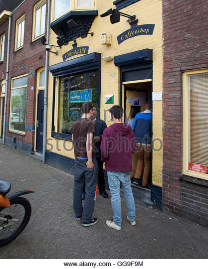 A bouncer checks the IDs of potential customers of the Toermalijn coffee shop in Tilburg April 29, 2012. A controversial - Stock Image