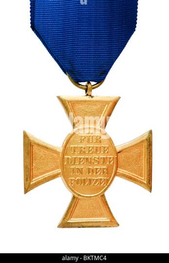 Vintage German Police 18 Year Long Service Award Medal 'Für Treue Dienste in der Polizei', isolated - Stock Image
