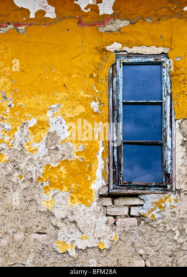 Old weathered painted wall and window for grunge background - Stock Image