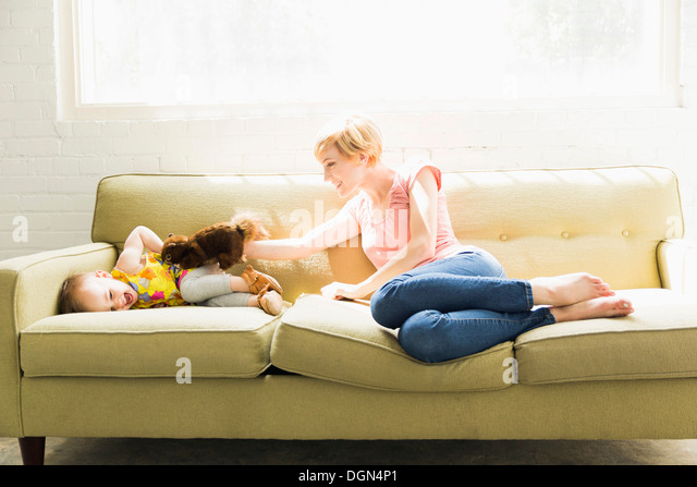 Mother playing with baby daughter (12-17 months) - Stock Image