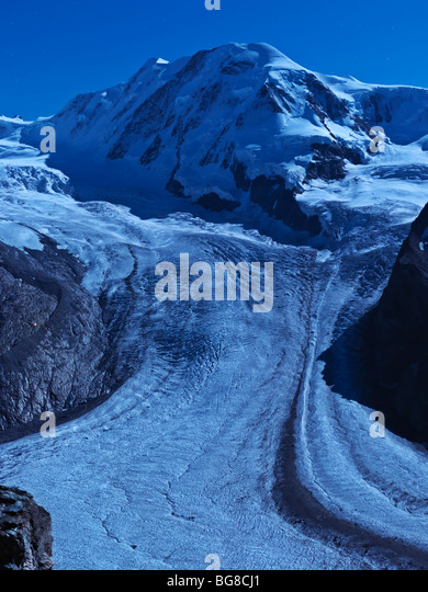 Switzerland, Valais, Zermatt, Gornergrat,Mount Breithorn and the Gorner Glacier illuminated by moon light - Stock Image
