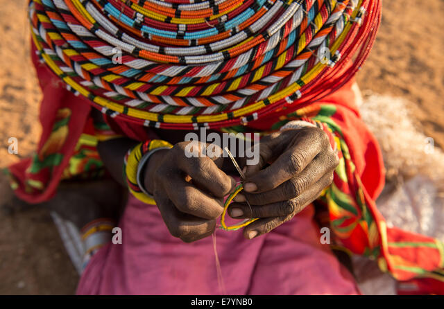Samburu women make beaded products in West Gate Conservancy.  One of NRT's main focuses is to help communities diversify - Stock Image