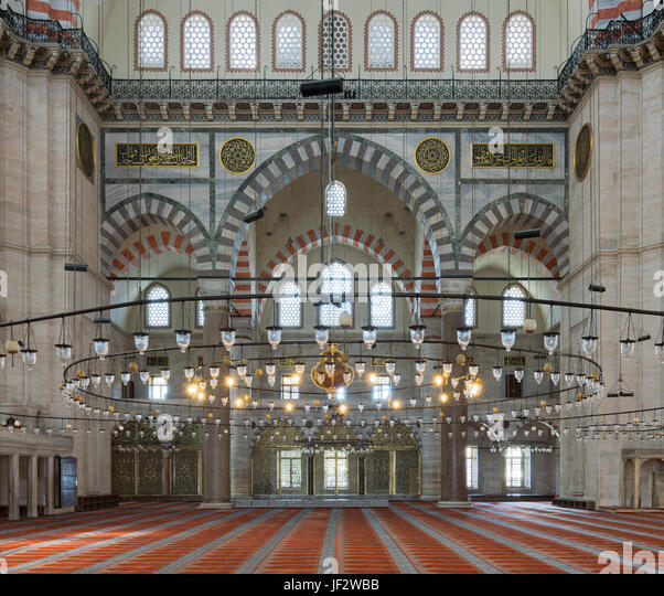 Interior of Suleymaniye Mosque, an Ottoman Baroque style mosque completed in 1755, with huge arches & many colored - Stock Image