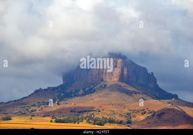 Towering hill surrounded by dramatic clouds at the end of the Great Escarpment and edge of The Southern African - Stock Image