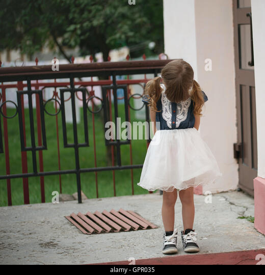 little cute shy girl on the street - Stock Image