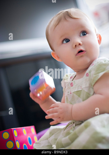 Baby playing with building blocks - Stock Image