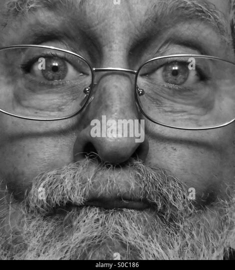 White male, age 64, close-up of bearded, aging face, Model Released, black and white - Stock-Bilder