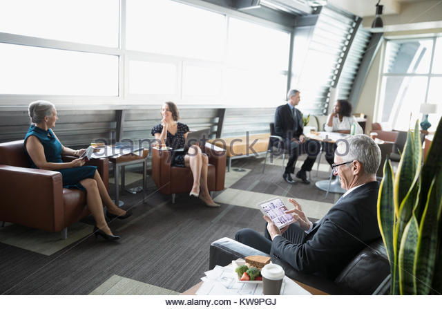Business people talking and working in business lounge - Stock Image