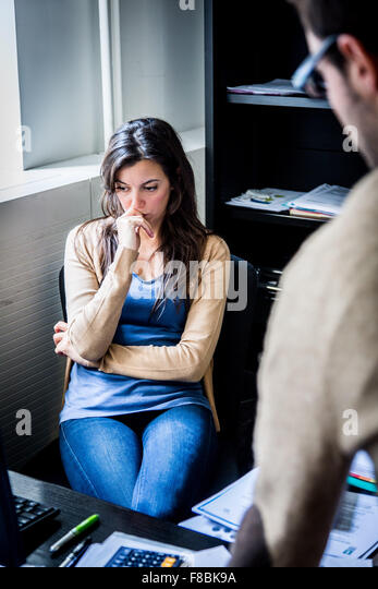 Stressed woman at work. - Stock Image