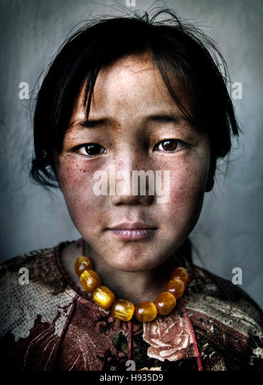 Mongolian Girl Portrait Innocent Culture Poverty Concept - Stock Image