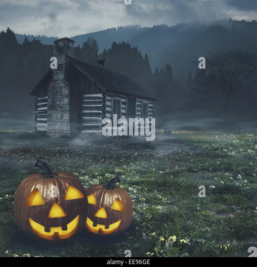 Abstract halloween backgrounds witn haunted house and pumpkin - Stock Image