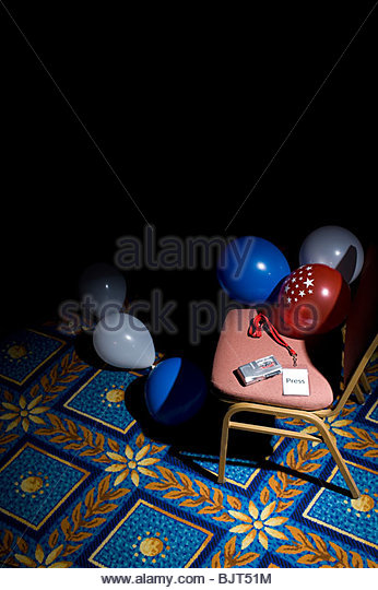 A press pass and tape recorder on a chair - Stock Image