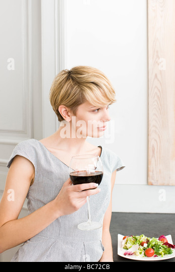 woman with glass of red wine - Stock-Bilder