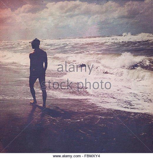 Man Walking In Surf - Stock Image