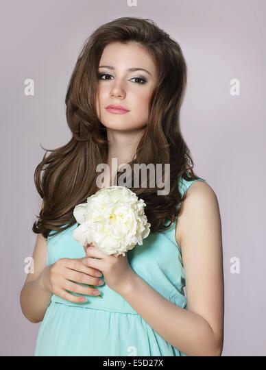 Nostalgia. Young Adorable Teen Girl with Peony Flower - Stock Image