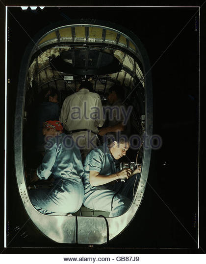 Working inside fuselage of a Liberator Bomber, Consolidated Aircraft Corp., Fort Worth, Texas - Stock Image
