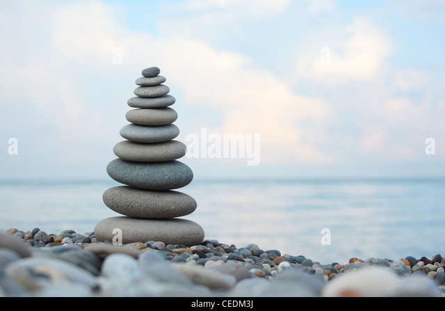 stone stack on pebble beach, Horizontal shot - Stock Image