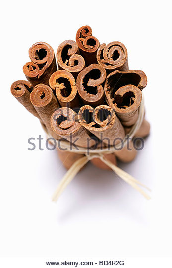 Cinnamon sticks, tied together - Stock Image