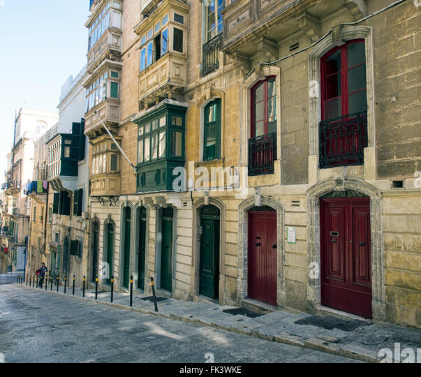 Typical housing with balconies in Valletta, capital of the Mediterranean island state of Malta - Stock Image