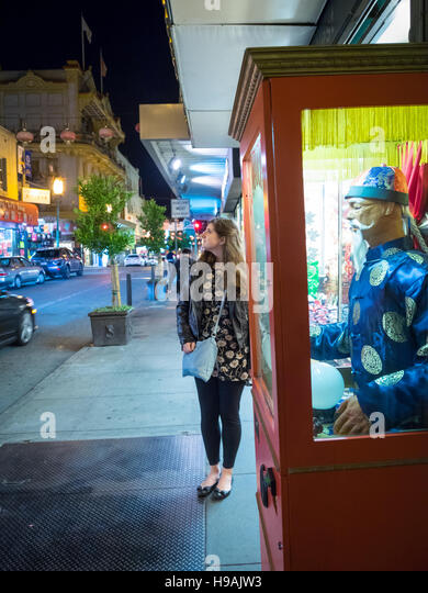 A pretty brunette girl on Grant Avenue in San Francisco's Chinatown. ***MODEL RELEASE AVAILABLE UPON REQUEST.*** - Stock Image
