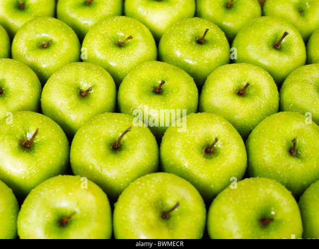 large group of green apples in a row. Horizontal shape - Stock Image