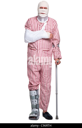 Photo of an injured man walking on crutches, isolated on a white background. - Stock Image
