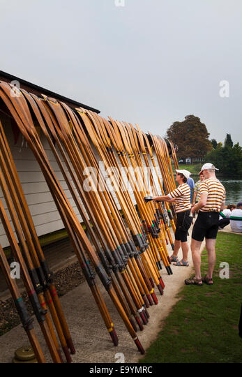 Club members selecting their oars for their skiff - Stock Image