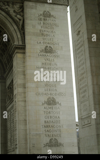 Commemorating the famous battles fought by France. Names carved into the pillars of the Arc de triomphe in Paris - Stock Image