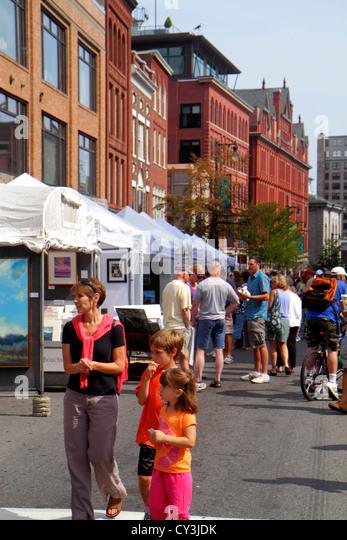 Portland Maine Congress Street WCSH 6 Sidewalk Art Festival artists vendors shopping historic buildings mother boy - Stock Image