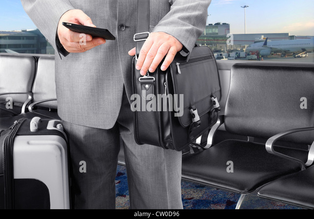 Traveling Businessman Calling by Phone at the Airport - Stock-Bilder