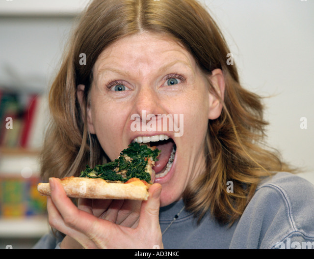 Pizza Witch Eating the Last Piece of Pizza - Stock-Bilder