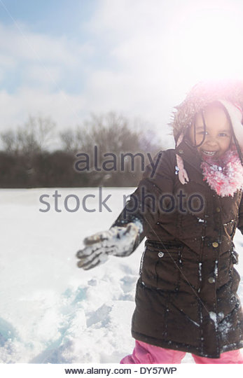 Young girl having fun in deep snow - Stock Image