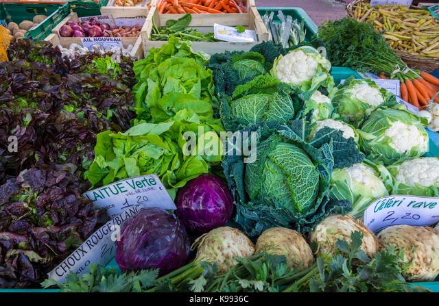 Fresh vegetables on market stall, France. - Stock Image