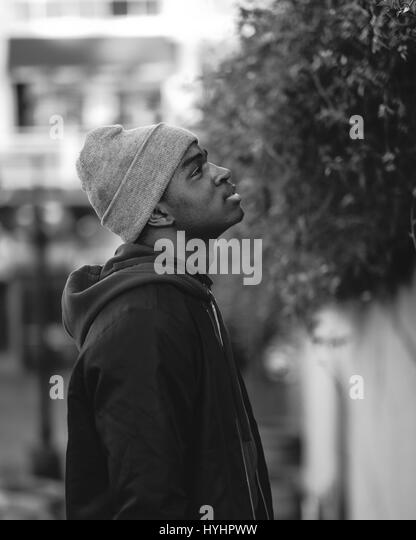 Profile portrait of a young african american man looking up - Stock Image