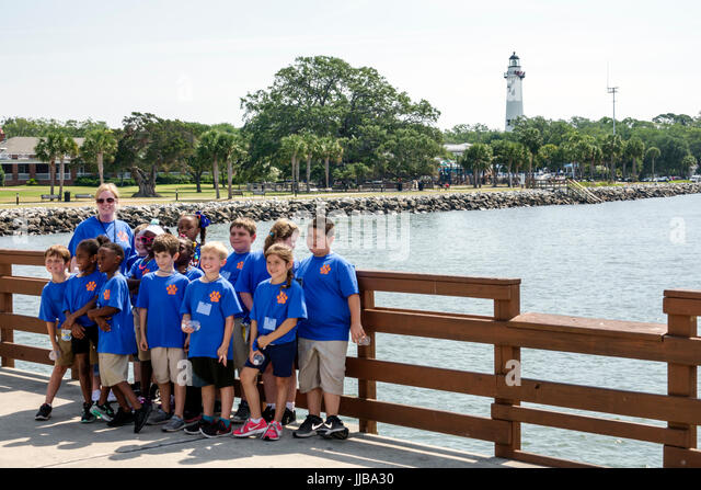 St. Saint Simons Island Georgia Neptune Park waterfront pier woman teacher boy girl school children student field - Stock Image