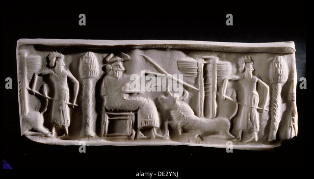 Modern impression of an Akkadian cylinder seal inscribed with a scene of a seated deity wearing horned headdress, - Stock Image