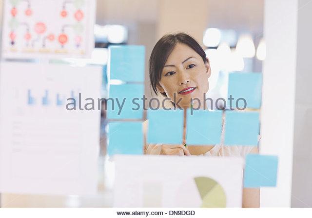 Businesswoman brainstorming ideas - Stock Image