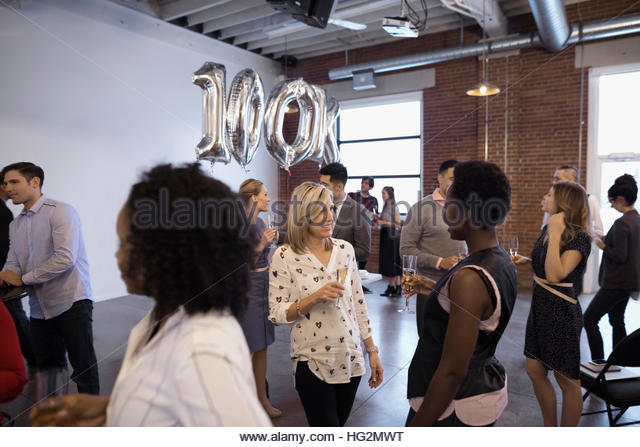 Business people networking and celebrating milestone - Stock Image