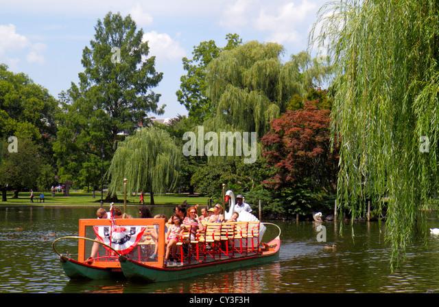 Boston Massachusetts Boston Public Garden Lagoon Swan Boat riders water - Stock Image